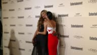 Laverne Cox and Angie Harmon at Entertainment Weekly's PreEmmy Celebration at Fig Olive Melrose Place on September 18 2015 in West Hollywood...