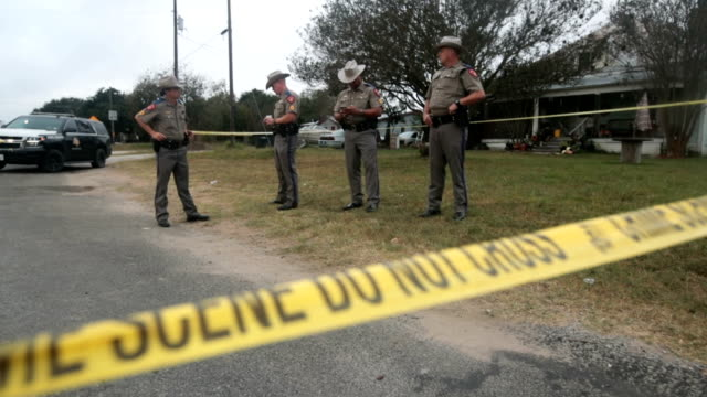 Law enforcement officials continue their investigation at the First Baptist Church of Sutherland Spring on November 7 2017 in Sutherland Springs...