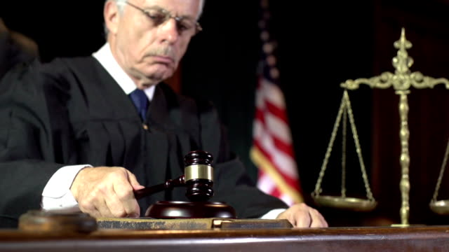 Law Judge using Gavel in Court - Super Slow Motion