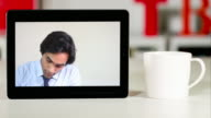 Lawyer listening to an off-camera client on a digital tablet device