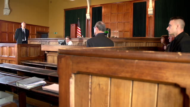 Lawyer questions witness in Courthouse - Two shots