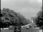 PARIS FRANCE CU 'Le Grande Hotel Paris' travel sticker LS ChampsElysees w/ traffic WS Arc de Triomphe BEHIND Painter in Palais des Tuileries garden...
