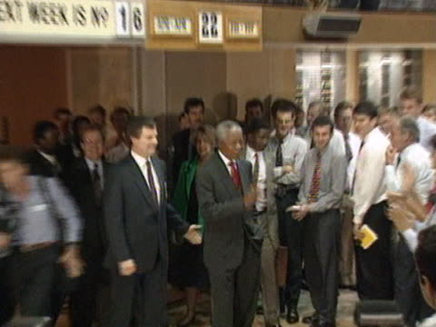 ANC leader Nelson Mandela visits the stock exchange in Johannesburg