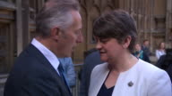Leader of the Democratic Unionist Party Arlene Foster and other party members discuss politics and pose for photos outside of the Houses of Parliament