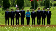 G7 leaders including German Chancellor Angela Merkek French President Francois Hollande UK PM David Cameron Japanese PM Shinzo Abe Itallian PM Matteo...