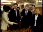 Leading policeman suspended from duty LIB PM Tony Blair speaking Mallon on a visit during election campaigning