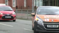 Learner drivers to be allowed on motorways T15041703 / Learner driver cars with Lplates along with sat nav on dashboard as driving along road