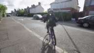 Leaving For School - Boy Rides Bicycle to School