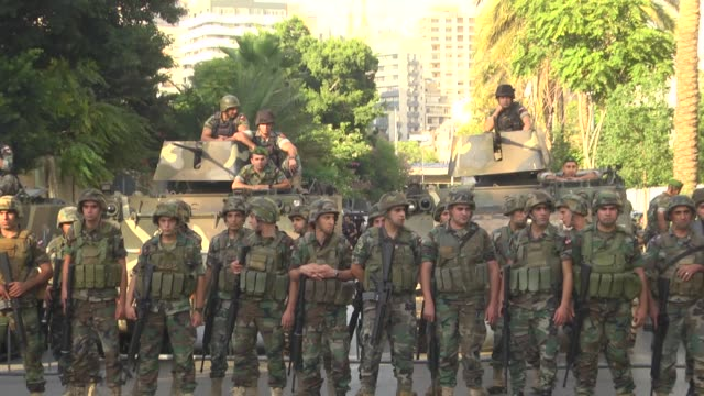 Lebanese soldiers stand at attention during a demonstration by Members and supporters of the Syrian Social Nationalist Party in front of the Court of...