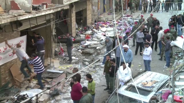 Lebanon held a day of mourning on Friday for 44 people killed in twin bombings on a busy shopping street in southern Beirut