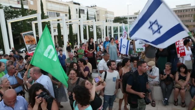 Left wing Israeli activists gathered in Tel Aviv on Thursday to protest against increasing violence and tension between Israelis and Palestinians in...