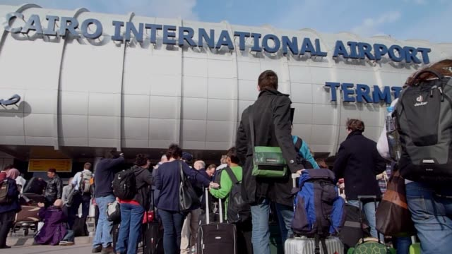 Legions of tourists foreign expatriates and worried Egyptians descended on Cairo airport on Sunday desperate to get on a flight and escape the...