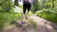 TS Legs of a female running through forest