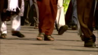 MS Legs of people walking on busy street/ India