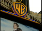 EXT LA 'WB' logo above hoarding advertising 'Two Weeks Notice' PULL GV Cinema
