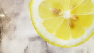 Lemon, ice and water background