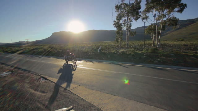 Lens flare and panning shot of biker on road/ Western Cape/ South Africa