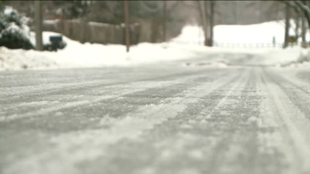Lens focuses on layer of ice forming on road