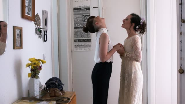 Lesbian couple getting ready for their wedding