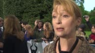 INTERVIEW Lesley Manville on her character how most of the cast are British the costume designs and the outfits at 'Maleficent' Premiere at on May 8...