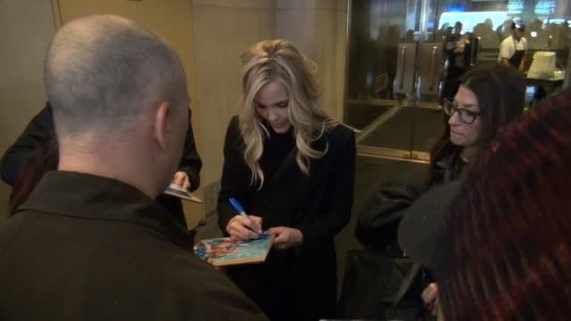 Leslie Bibb leaves the TODAY show signs and poses for photos with fans while writer Liz Tuccillo takes photos in Celebrity Sightings in New York
