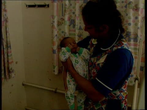 Abandoned Baby ITN ENGLAND East London Whipps Cross Hospital i/c TCS abandoned baby CMS nurse picks up amp holds baby CMS Det Insp Phillip Jones pkf...