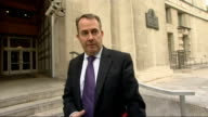 Liam Fox arrives at the Ministry of Defence ENGLAND London Whitehall Ministry of Defence EXT Liam Fox MP through gates and speaking to press SOT...