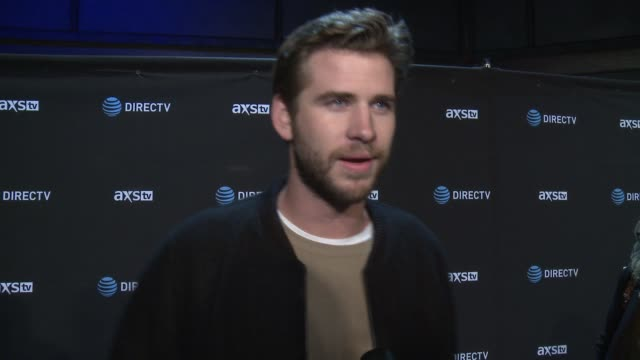INTERVIEW Liam Hemsworth on what brings him out how he's been enjoying his first Super Bowl experience learning the game of American football and who...