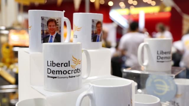 Liberal Democrats banners span the stage at the partys Spring conference in Liverpool UK on Sunday March 15 gvs of Liberal Democrats merchandise for...