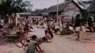 Liberated village and ANZAC and US Army soldiers / the Philippines