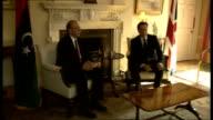 Libyan Interim Prime Minister Abdurrahim ElKeib visits Downing Street ENGLAND London Downing Street EXT Abdurrahim ElKeib out of car handshake and...