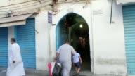 Libyan Muslims shop ahead of Eid alFitr during the holy month of Ramadan at Souq Erbaa Ligdim marketplace in Tripoli Libya on June 24 2017 Muslims...