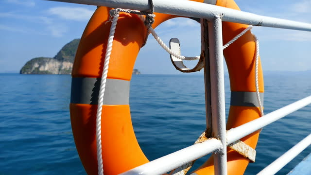 Life buoy on the side of the moving boat