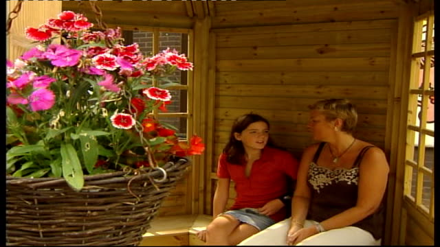 Cystic Fibrosis Ashley Parlane sitting in summer house talking to her mother