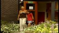 Cystic Fibrosis ENGLAND EXT Ashley Parlane and mother Shona Parlane along out of hospital and through garden DISSOLVE TO