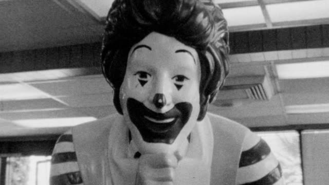 Life size statue of Ronald McDonald / Eating potato fries in front of statue / Close up of fries / Eating at McDonalds on November 01 1989 in Los...