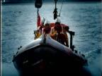 Lifeboat speeds through sea spraying water England