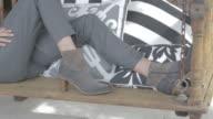 lifestyle fashion woman on porch swing