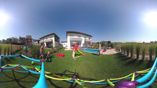 360 VR Lifestyle - little boy playing in garden 4K