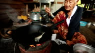Lifestyle Senior asian woman Sitting a Cooking Food, Slow motion