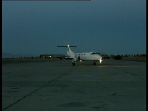 A UN light aircraft taxis at Kandahar airport