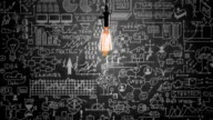 Light bulb and business strategy concept on blackboard