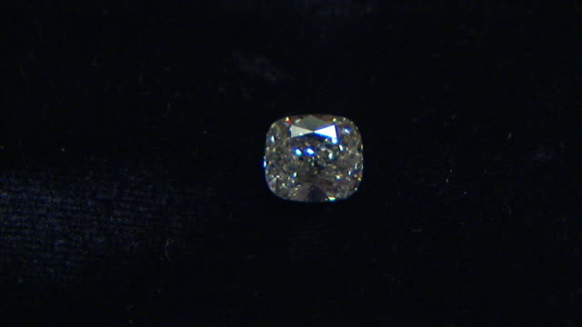 Light glints off the surface of a diamond.