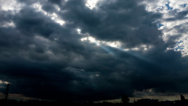 Light rays shine through the clouds