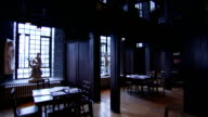 Light shines into the wood-panelled library of the Glasgow School of Art in Scotland. Available in HD.
