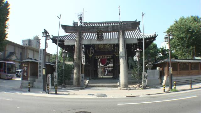 Light traffic passes the Kushida Shrine in Fukuoka City, Japan.