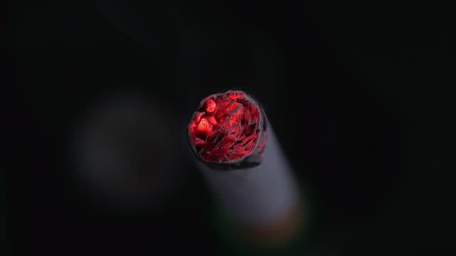 Lighter and Burning Cigarette against Black Background, Real Time