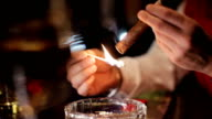 Lighting a cigar