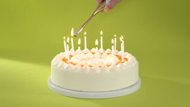 lighting candles on birthday cake