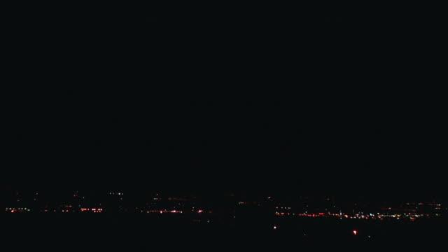 WS Lightning flashes across sky at night over cityscape / Tucson, Arizona, USA